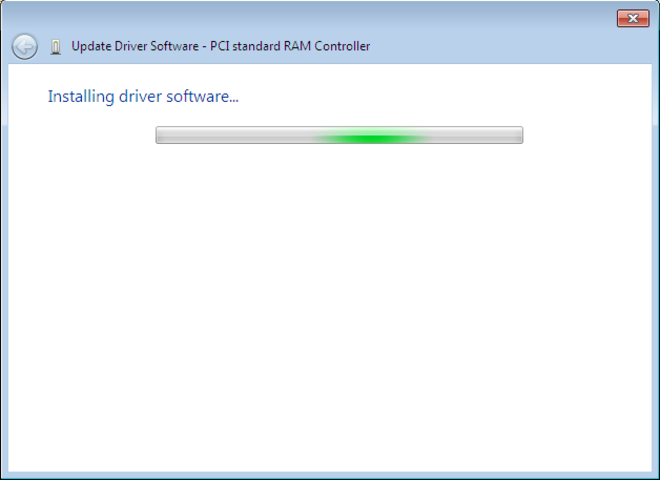 As the driver software installs, a flashing bar in the Update Driver Software wizard window shows the system is busy.