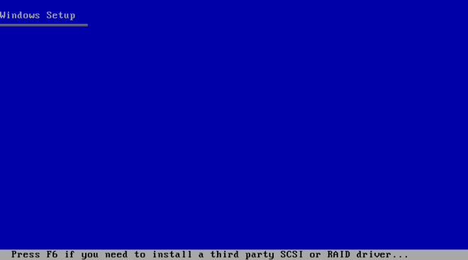"The Windows pre-installation blue screen reads Window Setup at the top in plain text, and ""Press F6 if you need to install a third party SCSI or RAID driver..."" at the bottom."